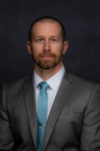 Headshot of Adam Duncan